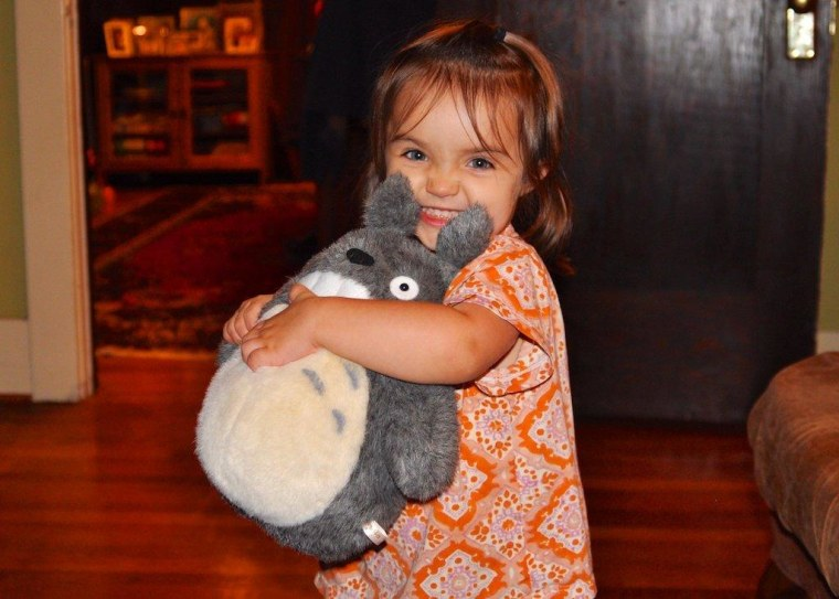 A Japanese culture geek in the making! Kristen Rutherford's 3-year-old daughter Vivienne hugs her stuffed Totoro tightly.