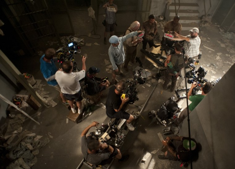 """The cast and crew film a scene from the season three premiere of """"Walking Dead."""""""