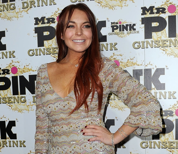 Actress Lindsay Lohan arrives at Mr. Pink Ginseng Drink launch party in Beverly Hills on Thursday.