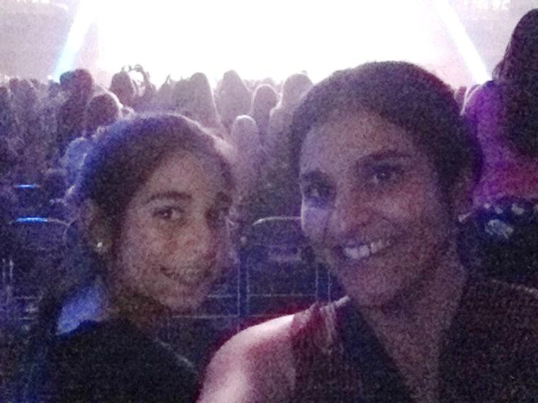 Kavita Varma-White (right) enjoys a mother-daughter bonding moment while daughter Priya enjoys the Justin Bieber concert.