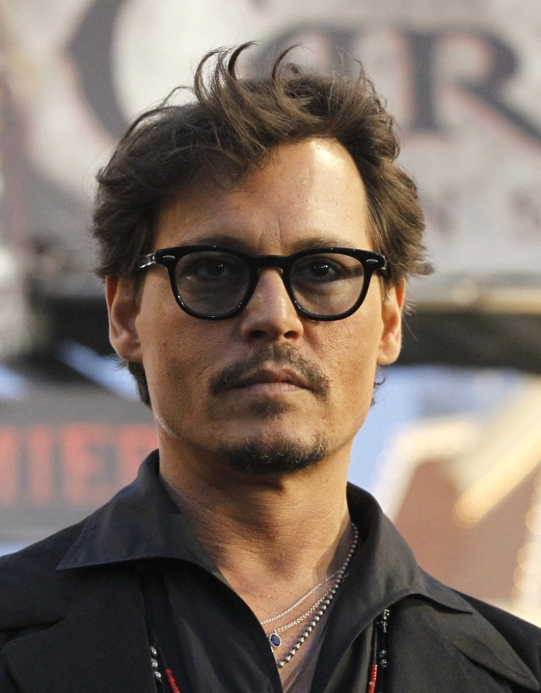 Johnny Depp poses at the premiere of