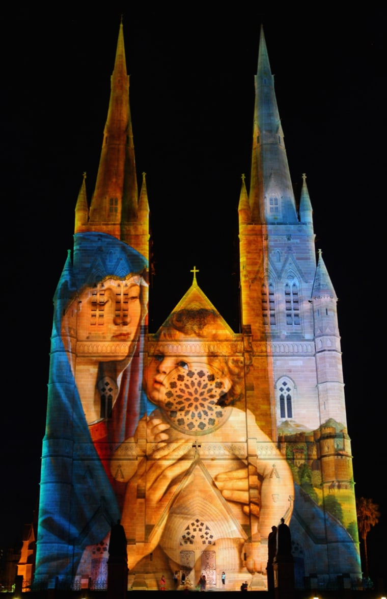 SYDNEY, AUSTRALIA - DECEMBER 18: The façade of St Mary's Cathedral is lit up during the Lights of Christmas celebration on December 18, 2011 in Sydney, Australia.