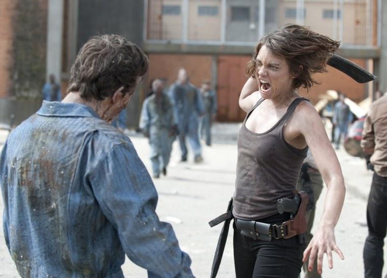 """Maggie (Lauren Cohan) takes on a zombie in \""""The Walking Dead\"""" season premiere."""