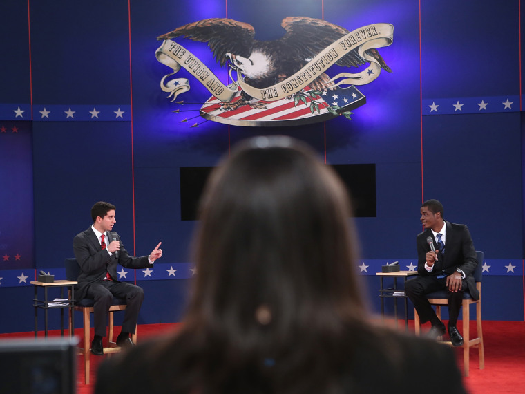 Hofstra University students Josh Ettinger (L) and Tevon Hyman (R) act as stand-ins for Mitt Romney and Barack Obama during stage rehearsals for the second presidential debate Tuesday.