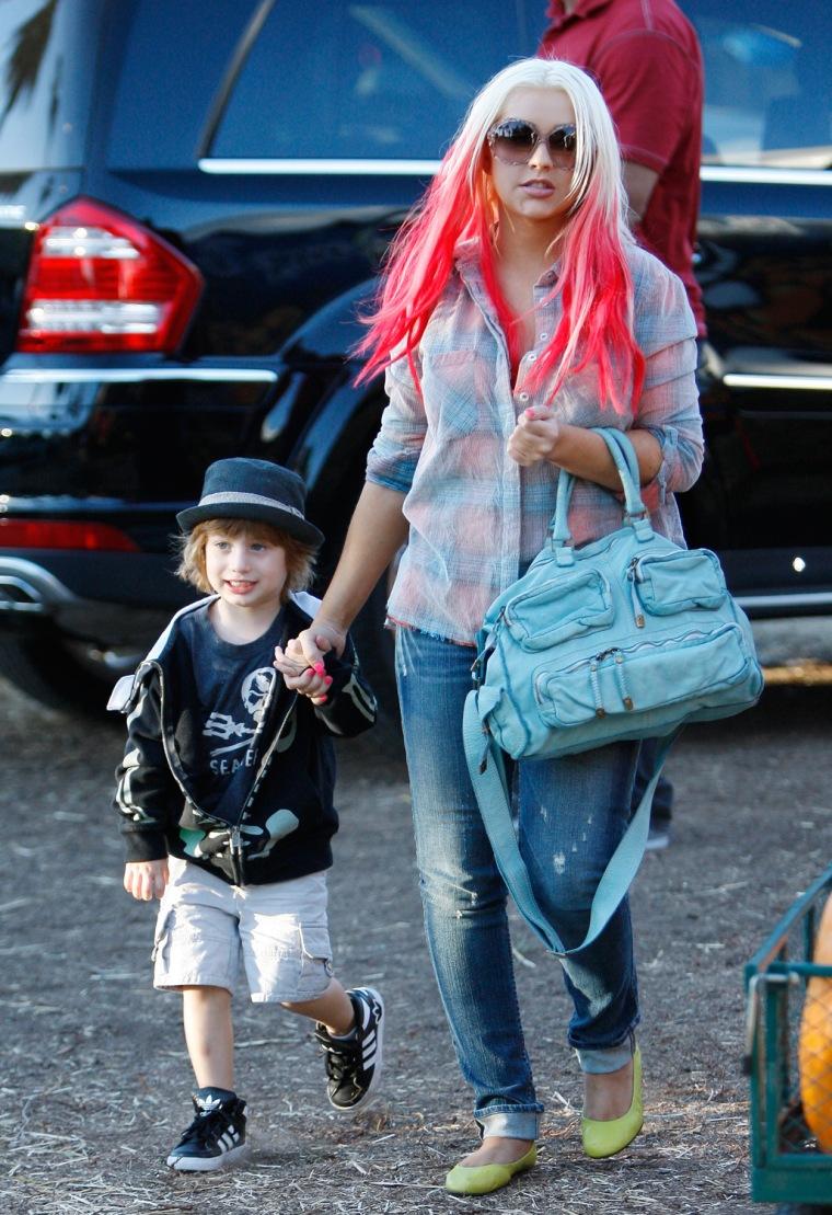 Christina Aguilera takes son Max to a pumpkin patch.