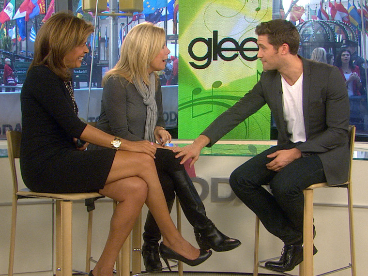 Getting touchy: Actor Matthew Morrison gets close to Kathie Lee.