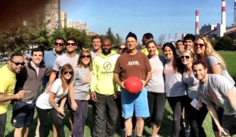 Bill Murray, holding the kickball.