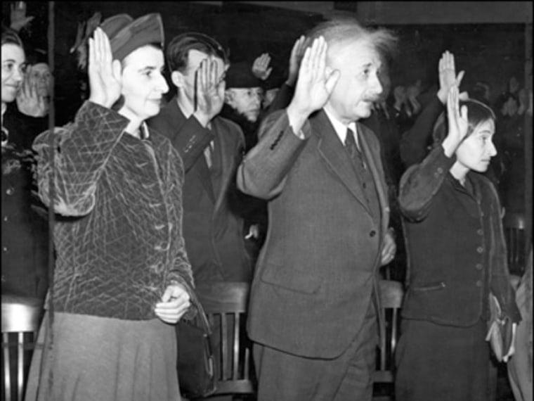 Albert Einstein being sworn-in as an American citizen during a naturalization ceremony.