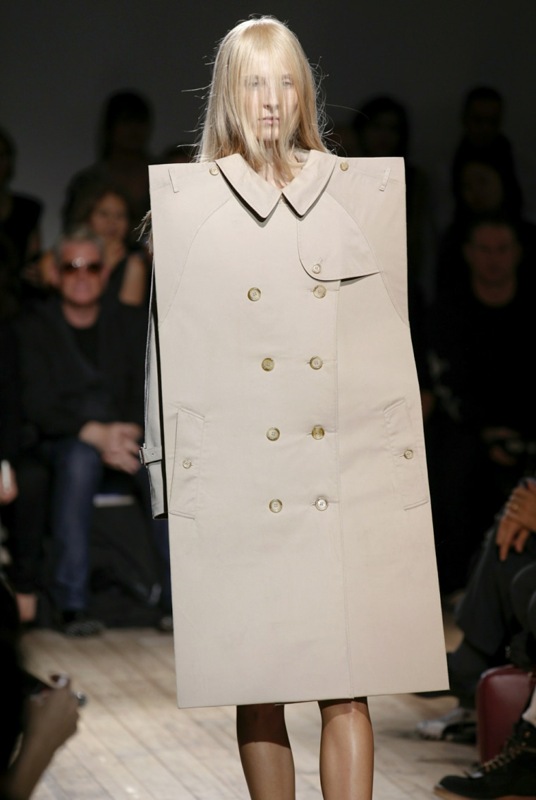 A bold look from the Maison Martin Margiela Spring/Summer 2011 show is modeled during Paris Fashion Week on Oct. 1, 2010. The designer brand is now releasing an affordable line for retailer H&M.