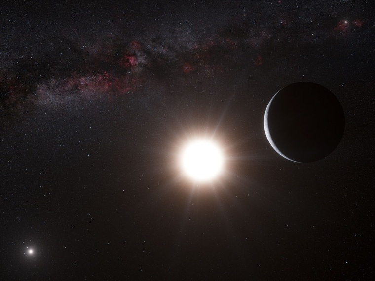 An artist's conception shows the planet orbiting Alpha Centauri B, a member of the triple-star system that's closest to Earth. Alpha Centauri B is the most brilliant object in the sky, with Alpha Centauri A at lower left and our own sun visible as a bright speck at upper right.