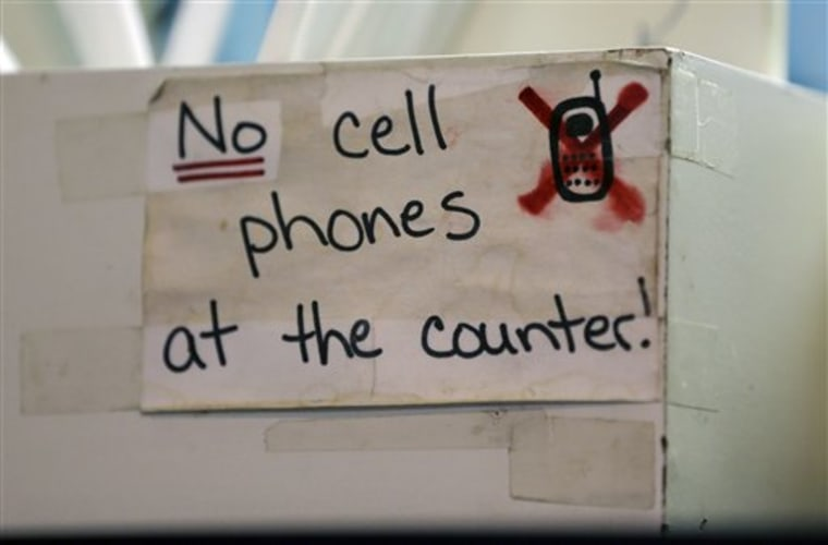 A sign at the Hamilton Street Cafe advises customers about cell phone policy at the restaurant, in Albany, N.Y.