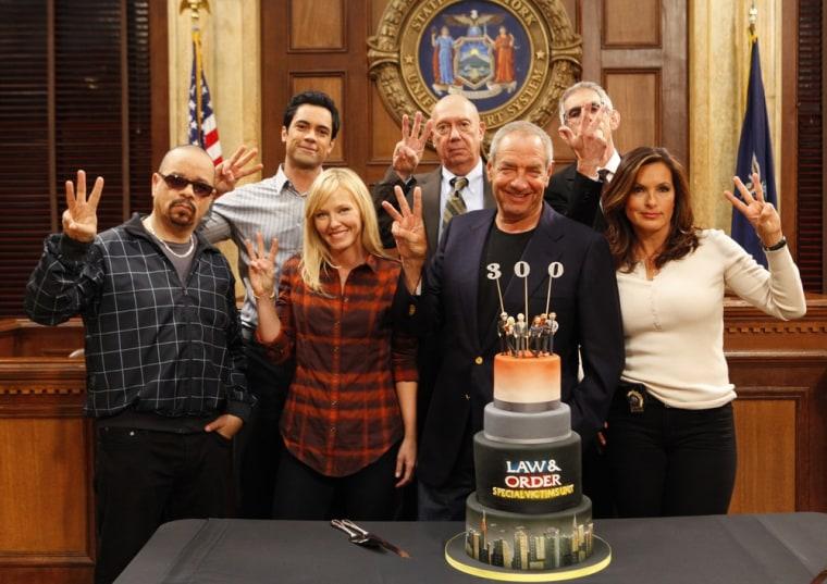 "From left, Ice-T, Danny Pino, Kelli Giddish, Dann Florek, executive producer Dick Wolf, Richard Belzer and Mariska Hargitay celebrate \""SVU's\"" 300th episode."