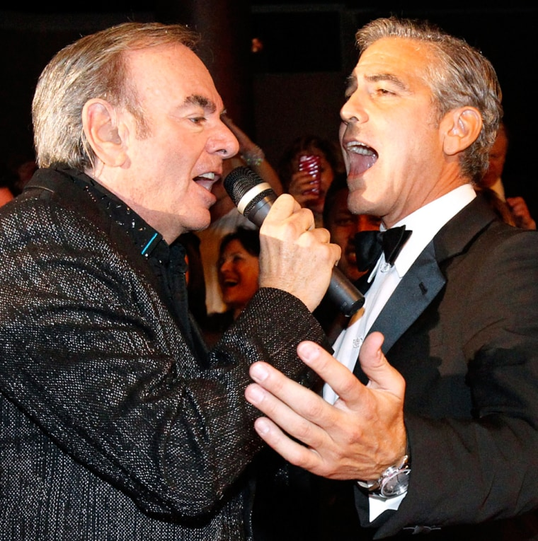 Actor and honoree George Clooney croons with Neil Diamond during the 26th Carousel of Hope Ball in Beverly Hills.