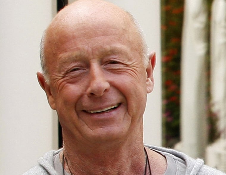 Director Tony Scott poses during a photocall in Paris in this July 20, 2009 file photo.