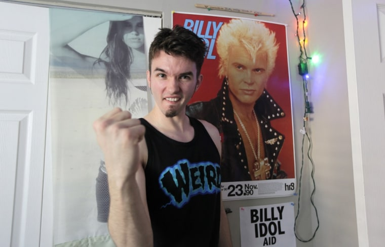 Michael Henrichsen poses in the bedroom of his home in Seattle next to a poster of rock star Billy Idol.