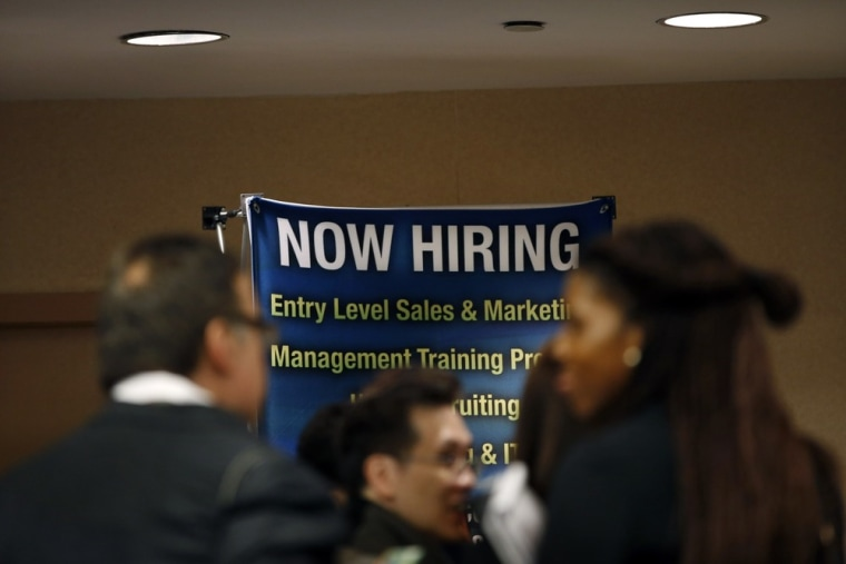 Job seekers wait to meet with employers at a career fair Wednesday in New York City.