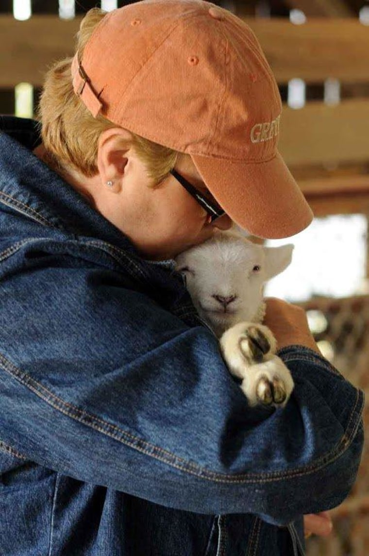Reg from Winchester, Ky., gives this baby lamb a hug and kiss.