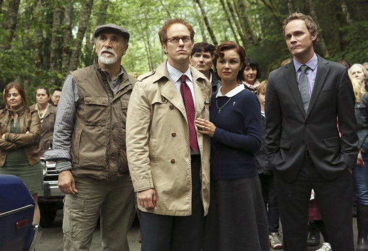 From left, Marco, Archie, Mother Superior and Dr. Whale stand at the edge of Storybrooke, prepared to leave for good.