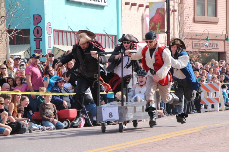 Shiver me timbers! A team dressed as pirates participates in the Emma Crawford Coffin Race in Manitou Springs, Colo.