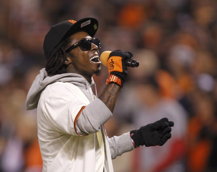 "Rapper Lil Wayne sings ""Take Me Out To The Ball Game"" at Game 6 of the playoff series between the St. Louis Cardinals and the San Francisco Giants on Oct. 21."