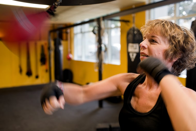 "Diane Mapes boxes three times a week for fitness and to strengthen her body for her upcoming reconstructive surgery. ""Boxing is my way to hit back,"" she says. ""Literally."""