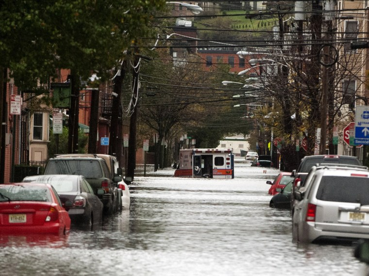 An ambulance sits abandoned in the middle of a flooded street on October 30, 2012 in Hoboken, New Jersey.