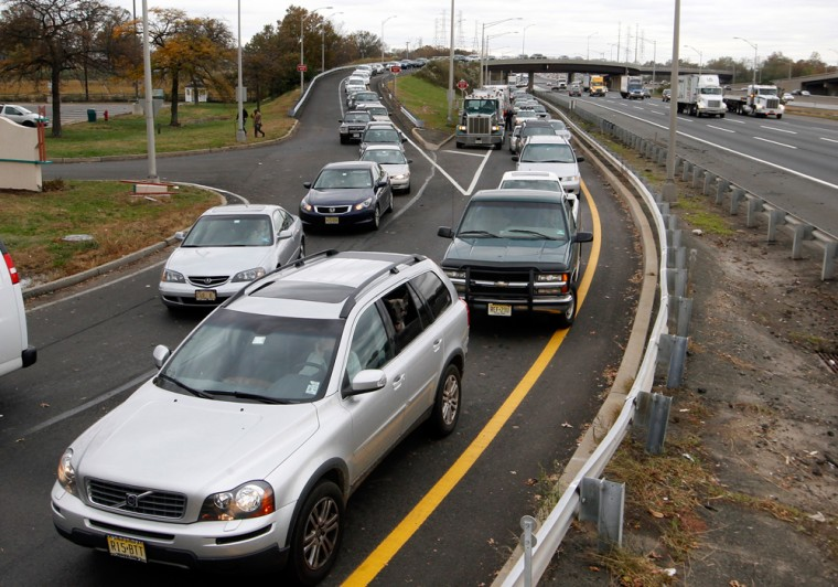 Cars line up for gas at the New Jersey Turnpike's Thomas A. Edison service area Wednesday, Oct. 31, 2012, near Woodbridge, N.J. After Monday's storm s...