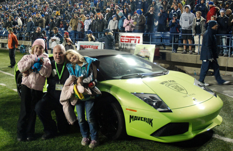 David Dopp posing for a photo with his daughters Shayla, left, and Olivia, right, after winning a Lamborghini on Nov.12, 2011 in Maverik's Sweepstakes.