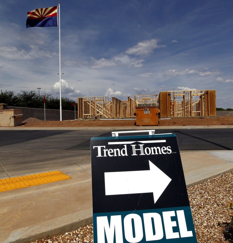 The first home in a new Trend Homes community sits under the Arizona flag in Gilbert, Ariz. Real estate experts say the Phoenix metro housing market is recovering faster than other U.S. cities, bolstered by an upswing in home prices and a decrease in the number of houses on the market.