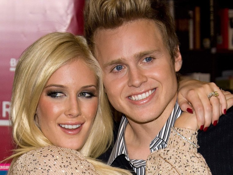 """Heidi Montag, left, and Spencer Pratt pose at a book signing event for their book """"How To Be Famous"""" at Borders Books in New York in November 2009."""
