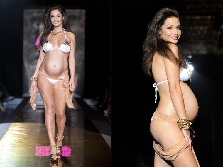 Sexy mama: Italian model Raffaella Fico presents a creation by Pin-Up Stars during Milan Fashion Week on Sept. 22.