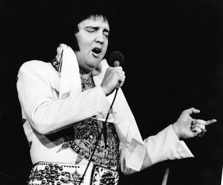 Elvis Presley performs in Providence, R.I., on May 23, 1977, three months before his death. Presley's doctor says that an enlarged and impacted colon played a role in the death of
