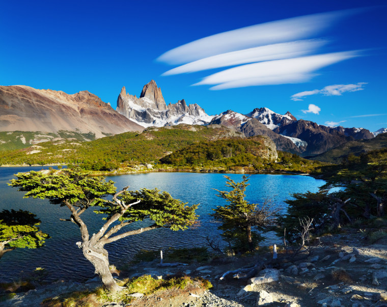 Monte Fitz Roy rises above the serene waters of Laguna Capri for a classic Patagonia view.