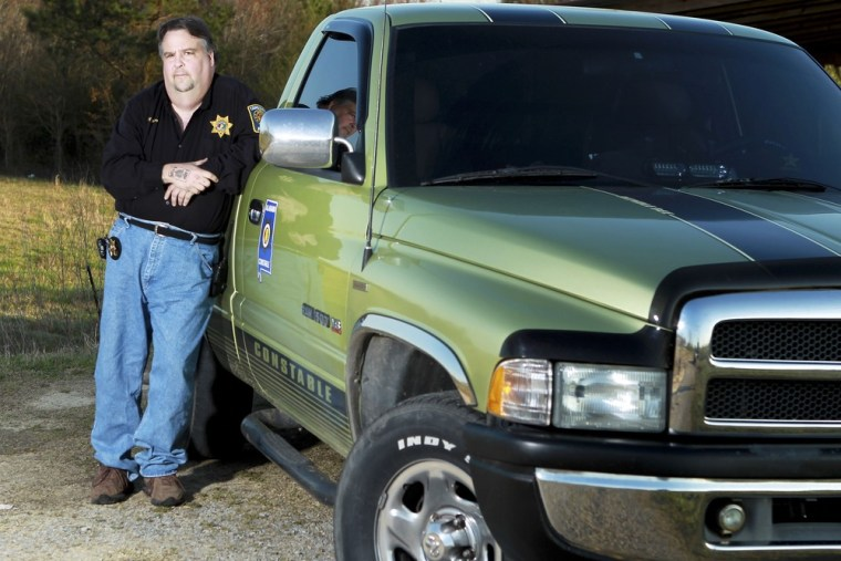 Jeffrey Nelson poses with his truck in rural Walker County in Alabama, March 28, 2013.