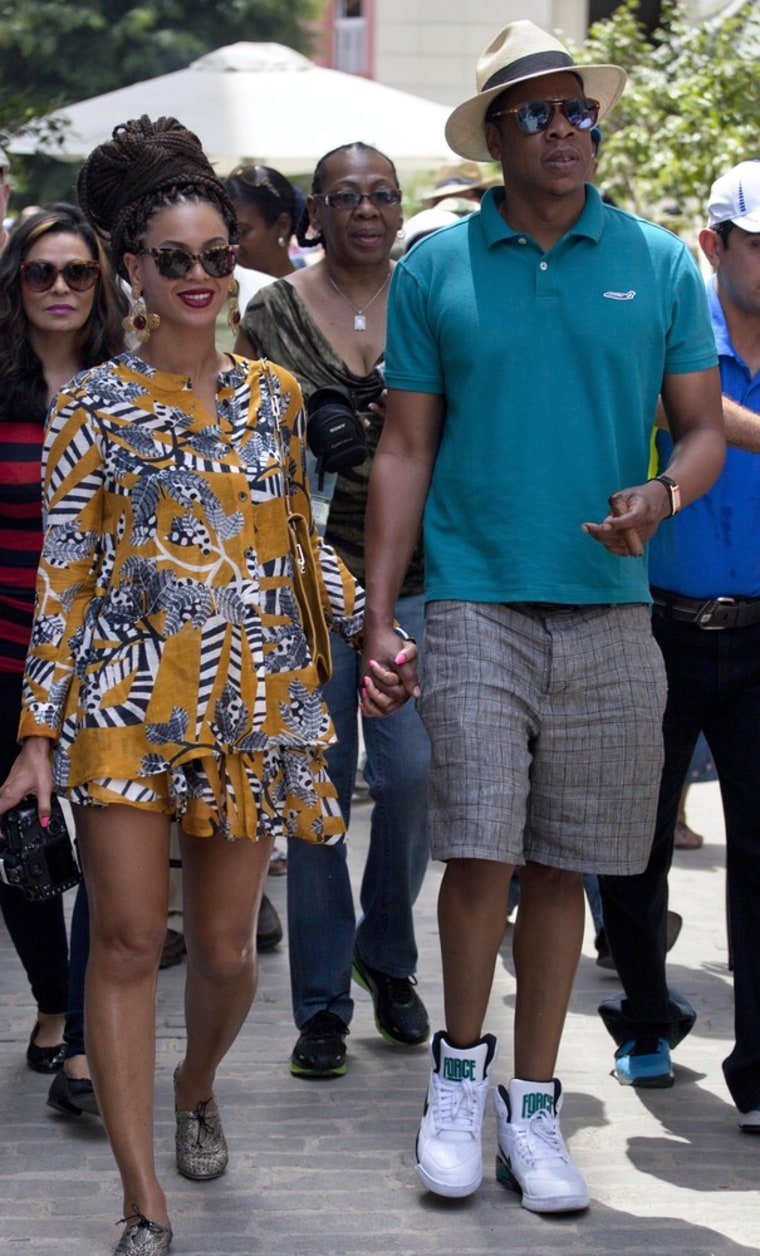 Beyonce and Jay-Z hold hands as they tour Old Havana, Cuba, on Thursday.