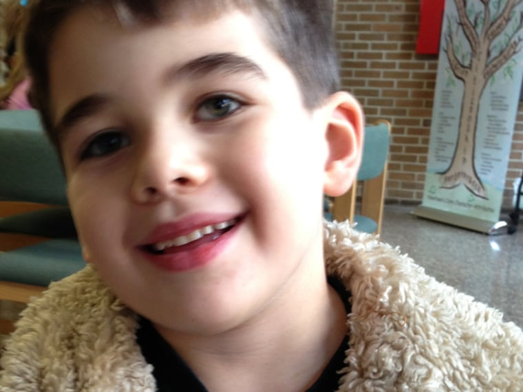 This Nov. 13, 2012 photo provided by the family via The Washington Post shows Noah Pozner. The six-year-old was one of the victims in the Sandy Hook e...