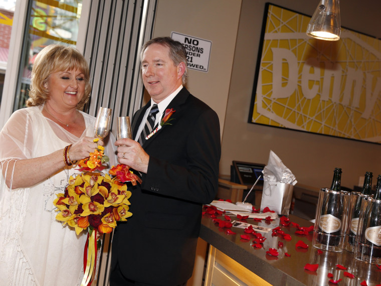 Nancy and Steven Keller toast following their wedding ceremony.
