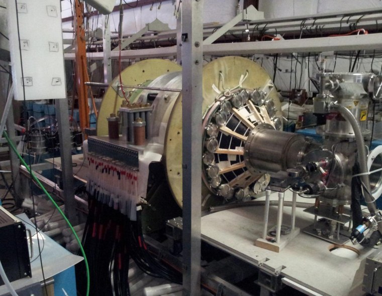 UW's Plasma Dynamics Lab has a vacuum chamber that is surrounded by two large, high-strength aluminum magnets. These magnets are powered by energy-storage capacitors that are connected by cables. The chamber is used to test a fusion-driven rocket technology.