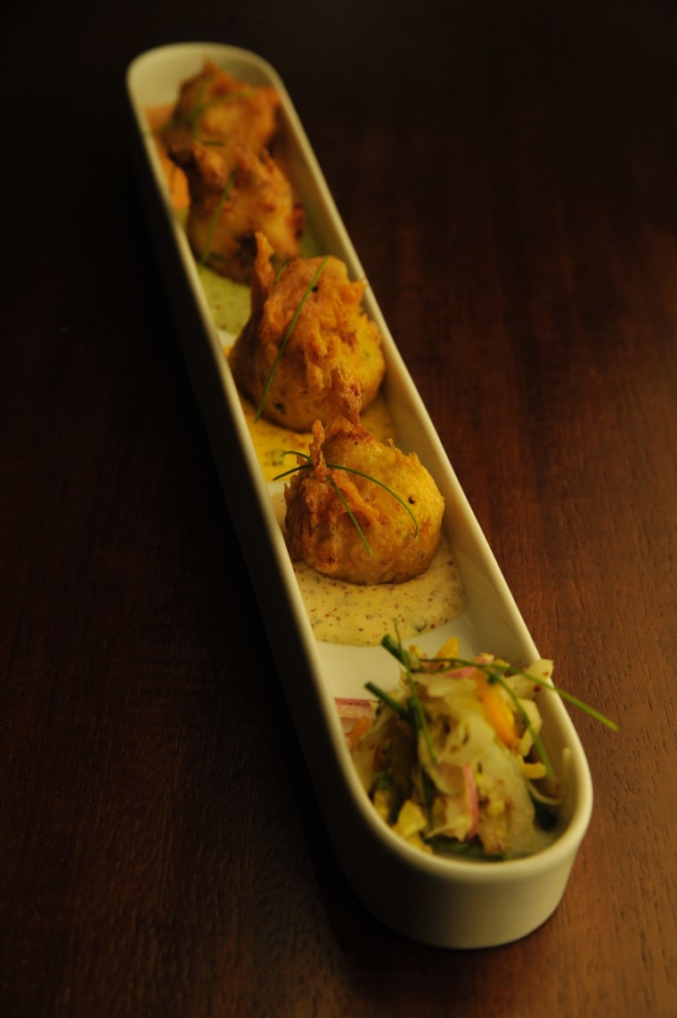 The crab beignet appetizer at R'evolution is one of the most popular items of the menu.