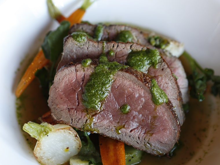 Rendell's pan-roasted venison is prepared in a Scotch broth with baby vegetables and parsley sauce.