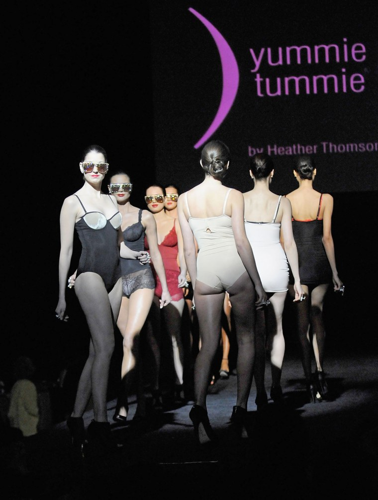 1e2a3c619a4db Models walk the runway wearing Yummie Tummie at a fashion show in New York  in 2010
