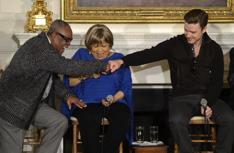 Justin Timberlake, right, fist bumps soul legend Sam Moore along with another legend, Mavis Staples, at the White House on Tuesday.
