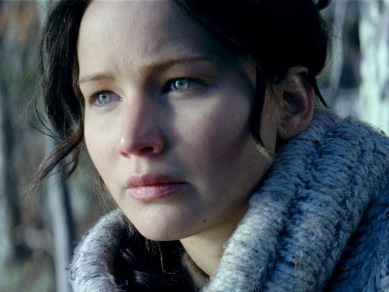 Jennifer Lawrence as Katniss Everdeen and Willow Shields as Primrose Everdeen in