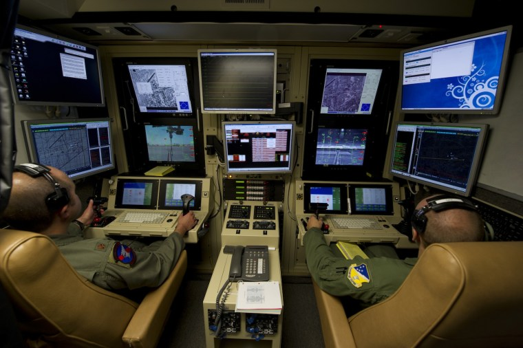 A 9th Attack Squadron MQ-9 Reaper pilot, left, and 49th Operations Group MQ-9 sensor operator fly an MQ-9 Reaper training mission from a ground control station on Holloman Air Force Base, N.M.