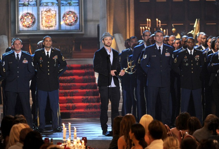 """Actor Justin Timberlake is surrounded by service members as he accepts the award for Entertainer of the Year osntage during Spike TV's 6th Annual """"Guys Choice Awards"""" in Culver City, Calif., on June 2."""