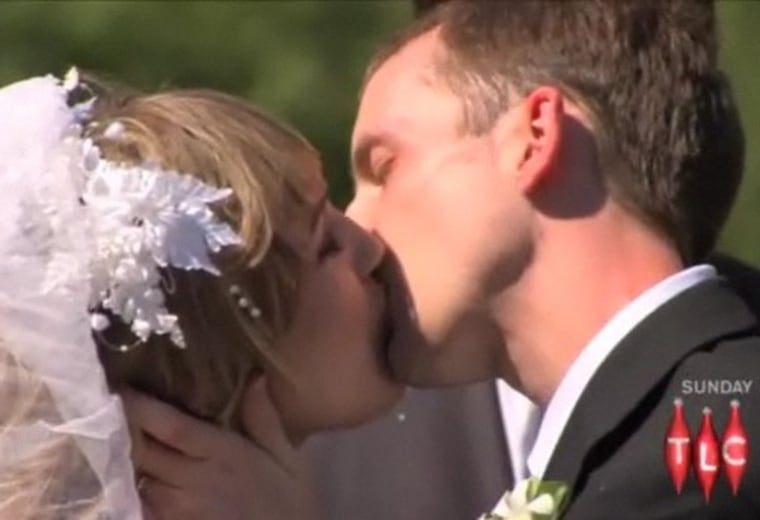 Shanna and Ryan share their first kiss, at their wedding.