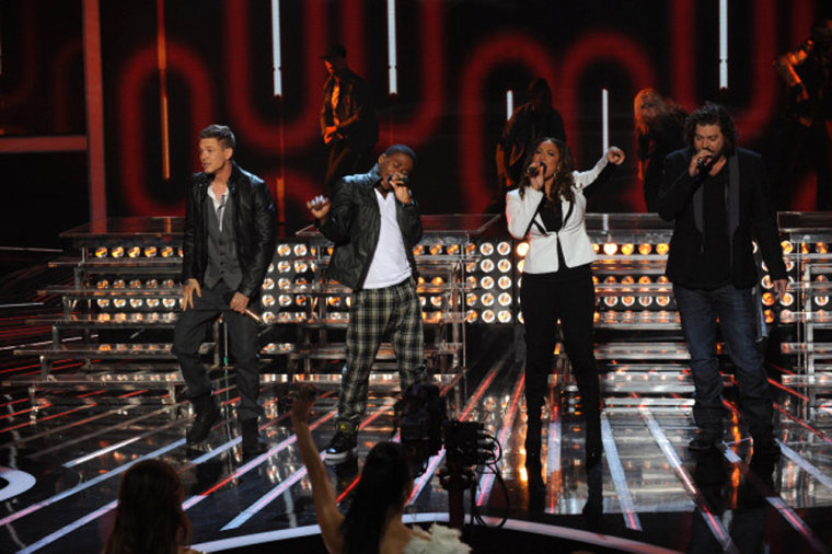 From left to right, Chris Rene, Marcus Canty, Melanie Amaro and Josh Krajcik share the stage on 'X Factor.'