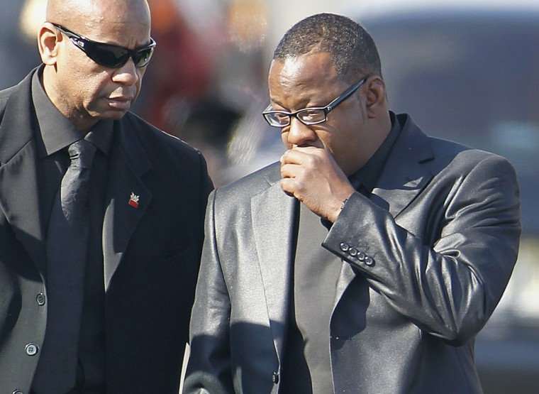 Red-eyed' Bobby Brown leaves Whitney Houston's funeral early