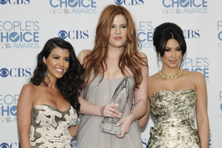 Kourtney, left, Khloe, center, and Kim Kardashian pose with their favorite guilty pleasure award for 'Keeping Up with the Kardashians' at the 2011 People's Choice Awards on Wednesday.
