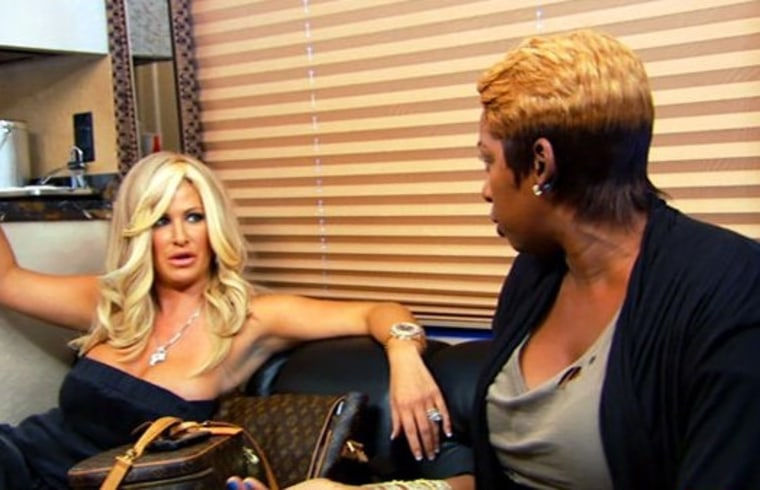 Kim, left, and NeNe have it out on the bus.
